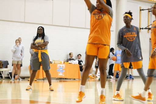 In this Oct. 3, 2017, photo provided by University of Tennessee Athletics, University of Tennessee women's NCAA college basketball assistant coach Bridgette Gordon, left, watches practice at Pratt Pavilion in Knoxville, Tenn. Gordon starred on two of Tennessee's national championship teams and reached the Final Four each of her four seasons with the Lady Volunteers. (Kyle Zedaker/University of Tennessee Athletics via AP)