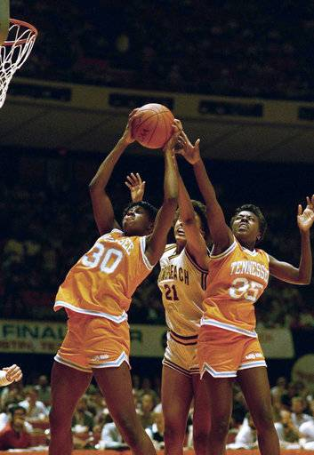 FILE - In this March 27, 1987, file photo, Bridgette Gordon (30) and Melissa McCray (35) of Tennessee double team Shannon Smith (21) of Cal State Long Beach as they go for a rebound during the first half of the NCAA Women's Final four semifinals in Austin, Texas. Bridgette Gordon starred on two of Tennessee's national championship teams and reached the Final Four each of her four seasons with the Lady Volunteers. Now the U.S. Olympic gold medalist is back at her alma mater as an assistant coach trying to help Tennessee regain the prominence it enjoyed during her own playing career.