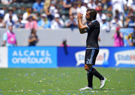 File - In this Sunday, Aug. 23, 2015 file photo, New York City FC midfielder Andrea Pirlo, of Italy, claps for fans as he is taken out of the game during the second half of an MLS soccer match against the Los Angeles Galaxy, in Carson, Calif. Tributes poured in for Andrea Pirlo after Italy's midfield maestro retired. The 38-year-old passing wizard played his final match on Sunday, Nov. 5, 2017 when New York City FC was beaten 4-3 by the Columbus Crew in the MLS Eastern Conference finals. Pirlo came on in the 90th minute of the match and was greeted with a showering of affection from fans at Yankee Stadium. While Pirlo played his final seasons in the United States, he made his name by helping AC Milan and Juventus win a combined six Serie A titles, two Champions Leagues with Milan and the above all the 2006 World Cup with Italy.