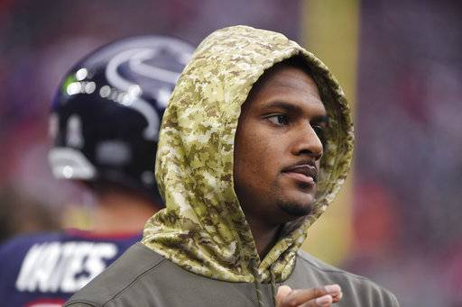 Injured Houston Texans quarterback Deshaun Watson stands on the sideline during an NFL football game against the Indianapolis Colts, Sunday, Nov. 5, 2017, in Houston.