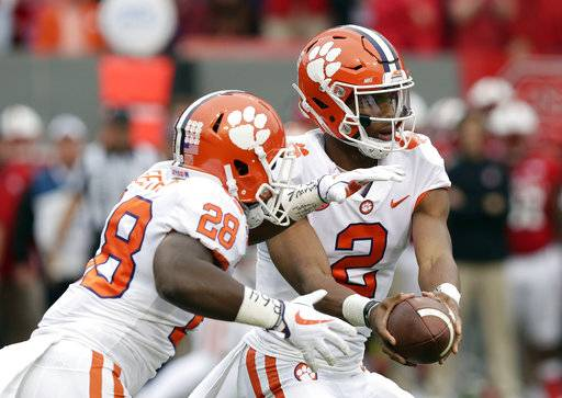 Clemson quarterback Kelly Bryant (2) hands off to Tavien Feaster (28) during the first half of an NCAA college football game against North Carolina State in Raleigh, N.C., Saturday, Nov. 4, 2017.