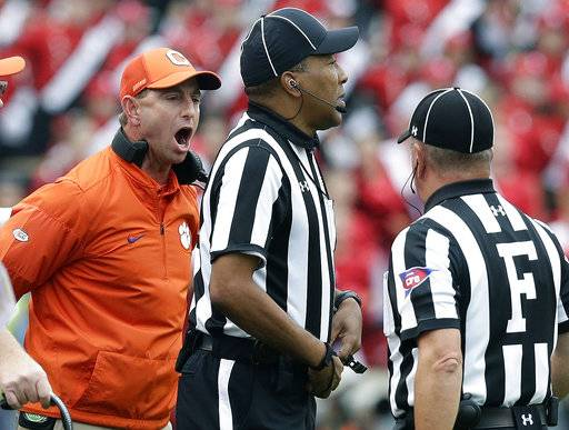 Clemson head coach Dabo Swinney argues with an official during the first half of an NCAA college football game against North Carolina State in Raleigh, N.C., Saturday, Nov. 4, 2017.