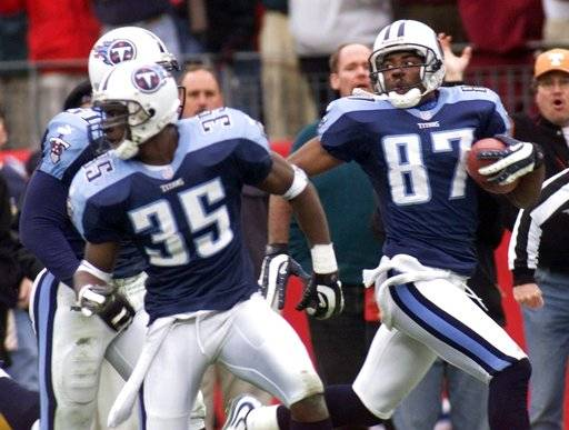 FILE - In this Jan. 8, 2000, file photo, Tennessee Titans wide receiver Kevin Dyson (87) looks back as he returns a kickoff with seconds remaining in the fourth quarter to defeat the Buffalo Bills in their AFC wild card football game in Nashville, Tenn. The ball was lateraled twice on the return and Dyson took it to the end zone. Blocking for Dyson are Perry Phenix (35) and Greg Favors (51). For every unplanned play that earns a name like the Immaculate Reception or the Musoc City Miracle, there's a gimmick cooked up by coaches to catch a defense by surprise.