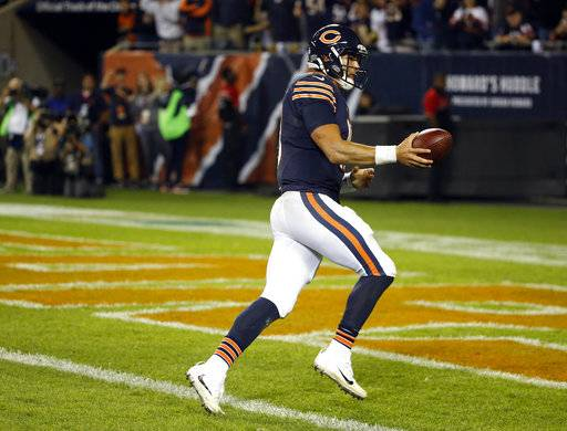 FILE - In this Oct. 9, 2017, file photo, Chicago Bears quarterback Mitchell Trubisky (10) runs to the end zone for a two-point conversion during the second half of an NFL football game against the Minnesota Vikings in Chicago. The best play trick play this season may have come in Chicago on a 2-point conversion against Minnesota, with Trubisky scoring on an intricate play based on timing, execution and misdirection.