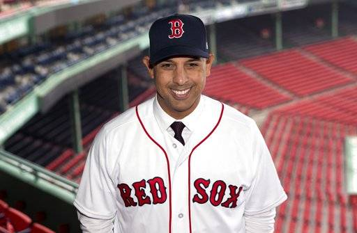 Boston Red Sox new manager Alex Cora poses in Fenway Park following an introductory news conference in Boston, Monday, Nov. 6, 2017.
