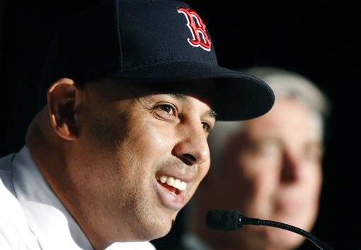 Alex Cora, left, smiles beside Boston Red Sox President of Baseball Operations Dave Dombrowski, during a news conference where Cora was introduced as the Red Sox baseball teams new manager, Monday, Nov. 6, 2017, in Boston.