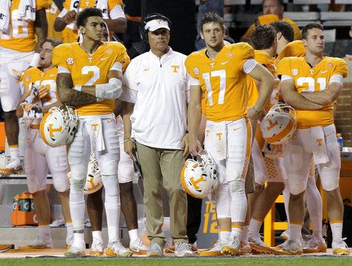Tennessee quarterbacks Jarrett Guarantano (2) and Will McBride (17) stand with quarterbacks coach Mike Canales on the sideline during an NCAA college football game against Southern Mississippi in Knoxville, Tenn., Saturday, Nov. 4, 2017. (C.B. Schmelter/Chattanooga Times Free Press via AP)