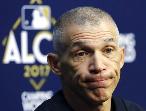 FILE - In this Oct. 12, 2017, file photo, New York Yankees manager Joe Girardi talks before batting practice for Game 1 of the American League Championship Series against the Houston Astros, in Houston. The New York Yankees announced Thursday, Oct. 26, 2017, that Girardi will not return to the team in the 2018 season. The announcement was made by Yankees Senior Vice President and General Manager Brian Cashman.