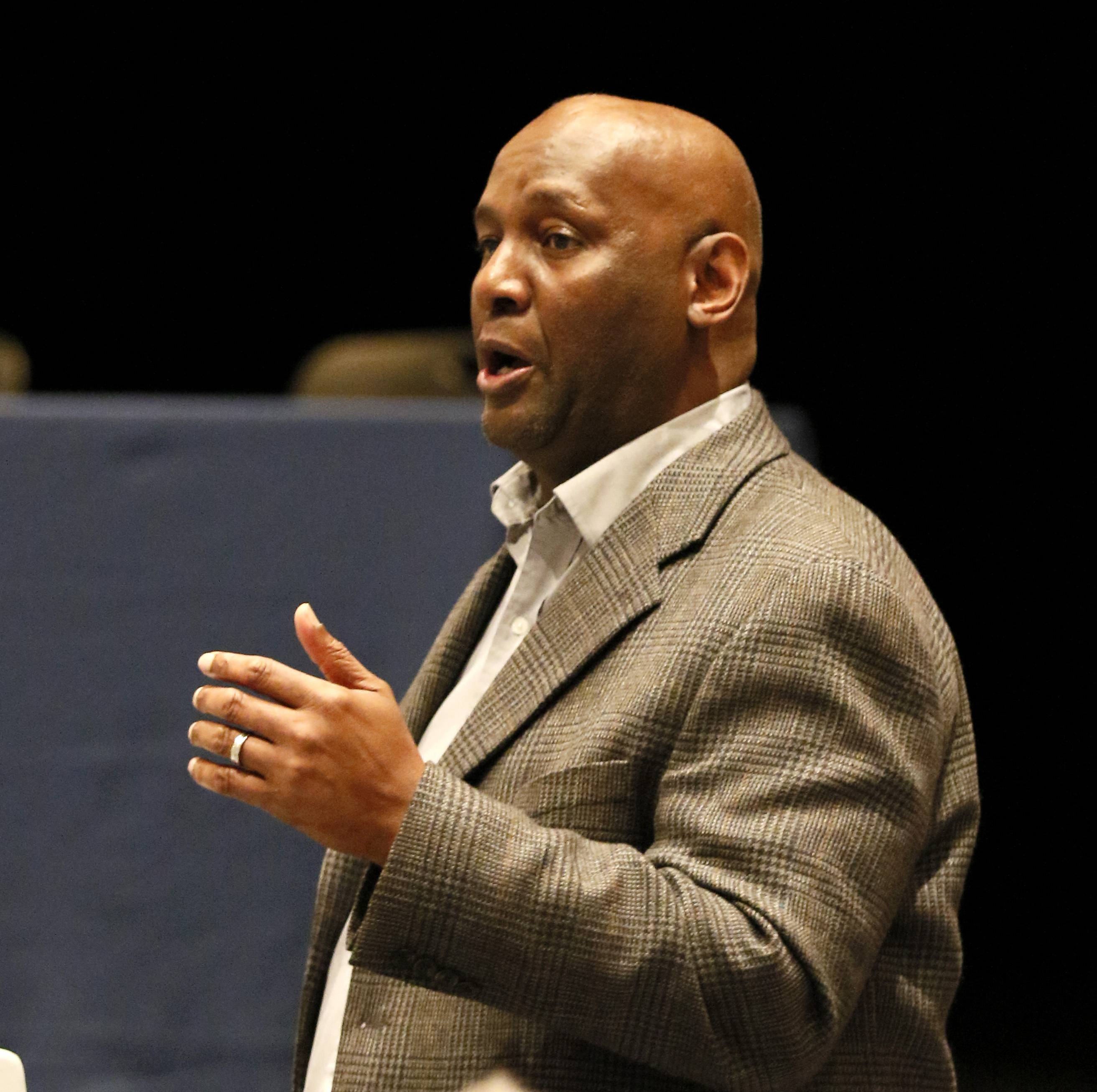 Ron Raglin, an assistant superintendent at Elgin Area School District U-46, speaks during last weekend's panel discussion on improving educational prospects for black males.