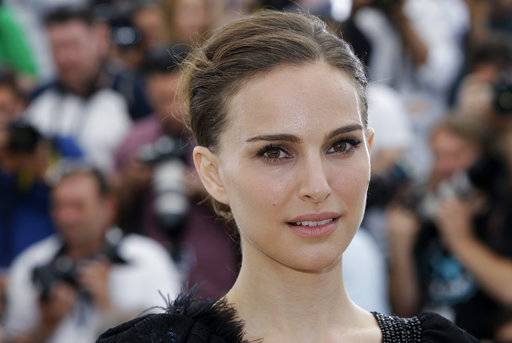 "FILE - In this May 17, 2015 file photo, Natalie Portman poses for photographers during a photo call at the 68th international film festival, Cannes, southern France. On Tuesday, Nov. 7, 2017, Natalie Portman was awarded Israel's 2018 Genesis Prize, a $1 million recognition that is widely known as the ""Jewish Nobel Prize.� Organizers of the prize announced Tuesday that they were recognizing the Oscar-winning actress for her commitment to social causes and deep connection to her Jewish and Israeli roots. (AP Photo/Lionel Cironneau, File)"