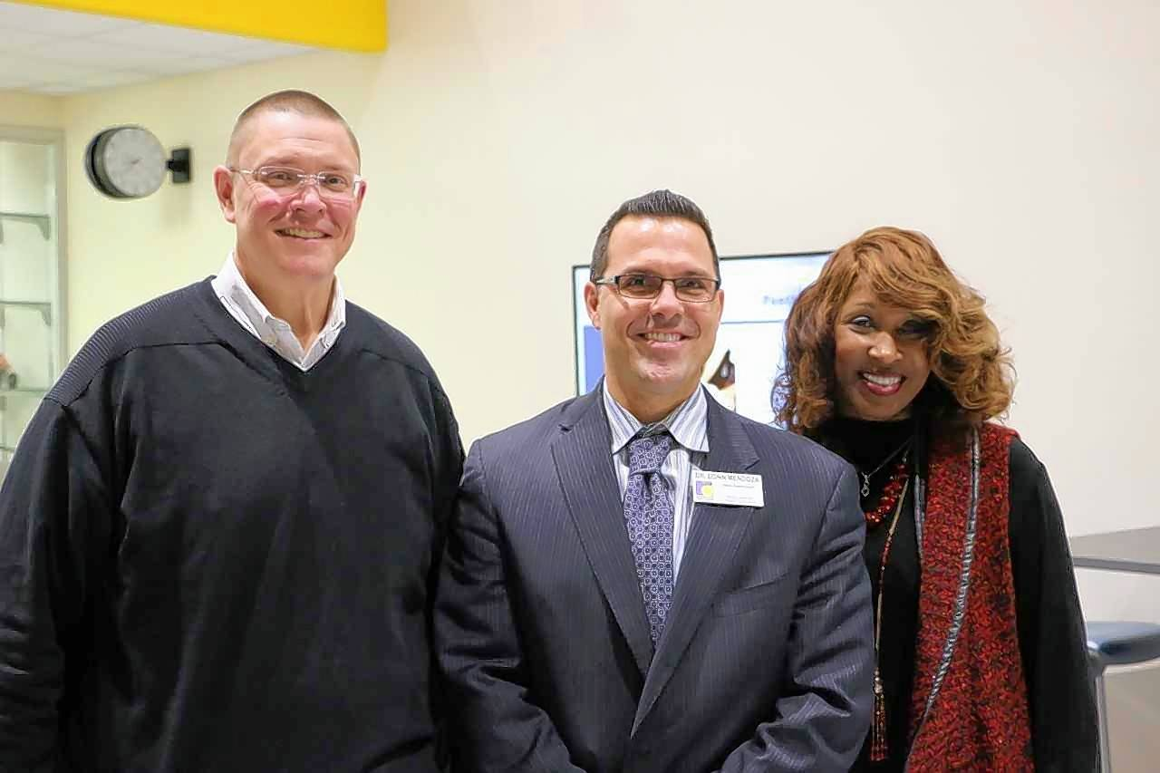 From left to right, Round Lake Area School District 116 Board President Kevin Daniels, Deputy Superintendent Donn Mendoza and Superintendent Constance Collins pose for a picture after the board selected Mendoza as Collins' successor.