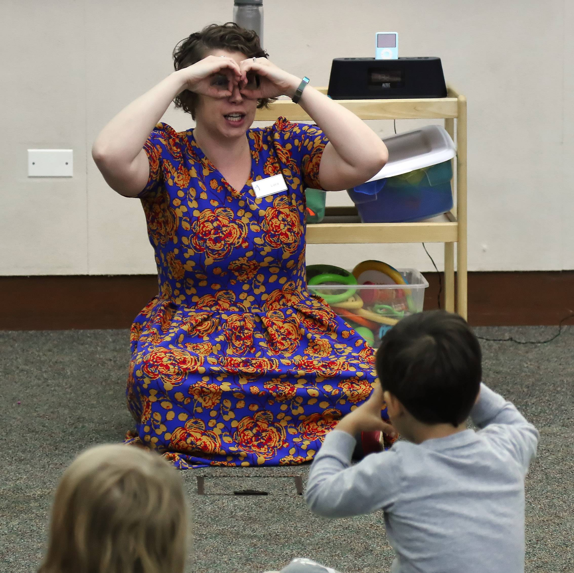 "Youth services librarian Lora Siebert sings ""These are My Glasses"" during the Family Dance Party at Lake Villa District Library on Tuesday. About 60 children, parents and caregivers danced and played instruments during the musical program."