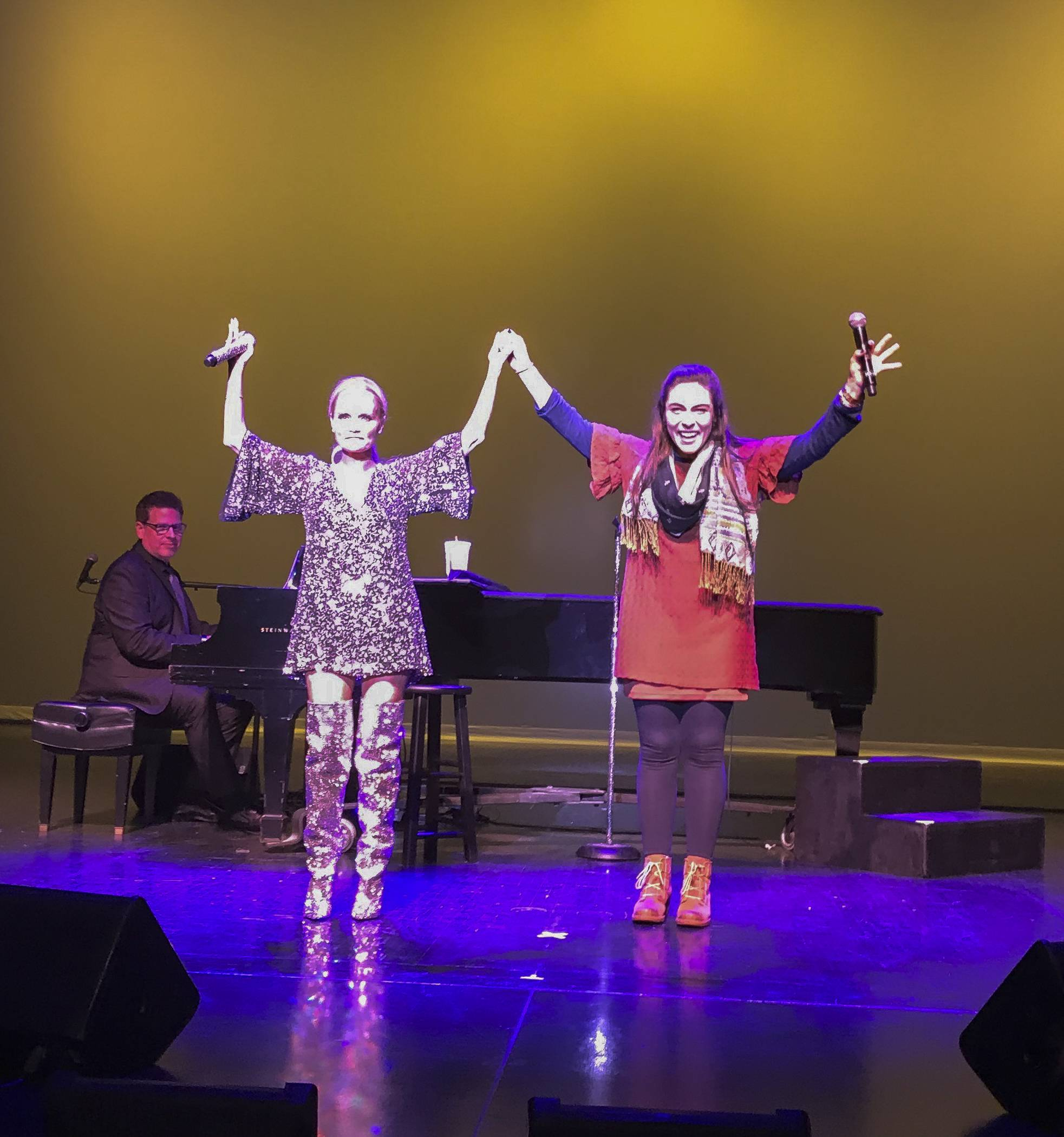 Kristin Chenoweth and Libertyville teacher Allison Zabelin take a bow after performing a duet Saturday at the Paramount Theatre in Aurora.