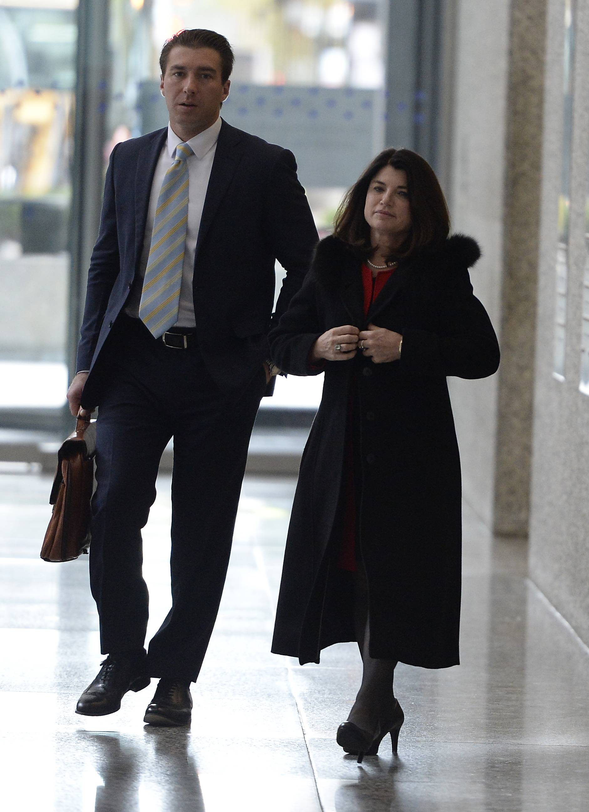 Former College of DuPage board Chairwoman Kathy Hamilton leaves federal court Tuesday after an appellate court hearing on whether former COD President Robert Breuder's contract was valid at the time of his October 2015 firing.