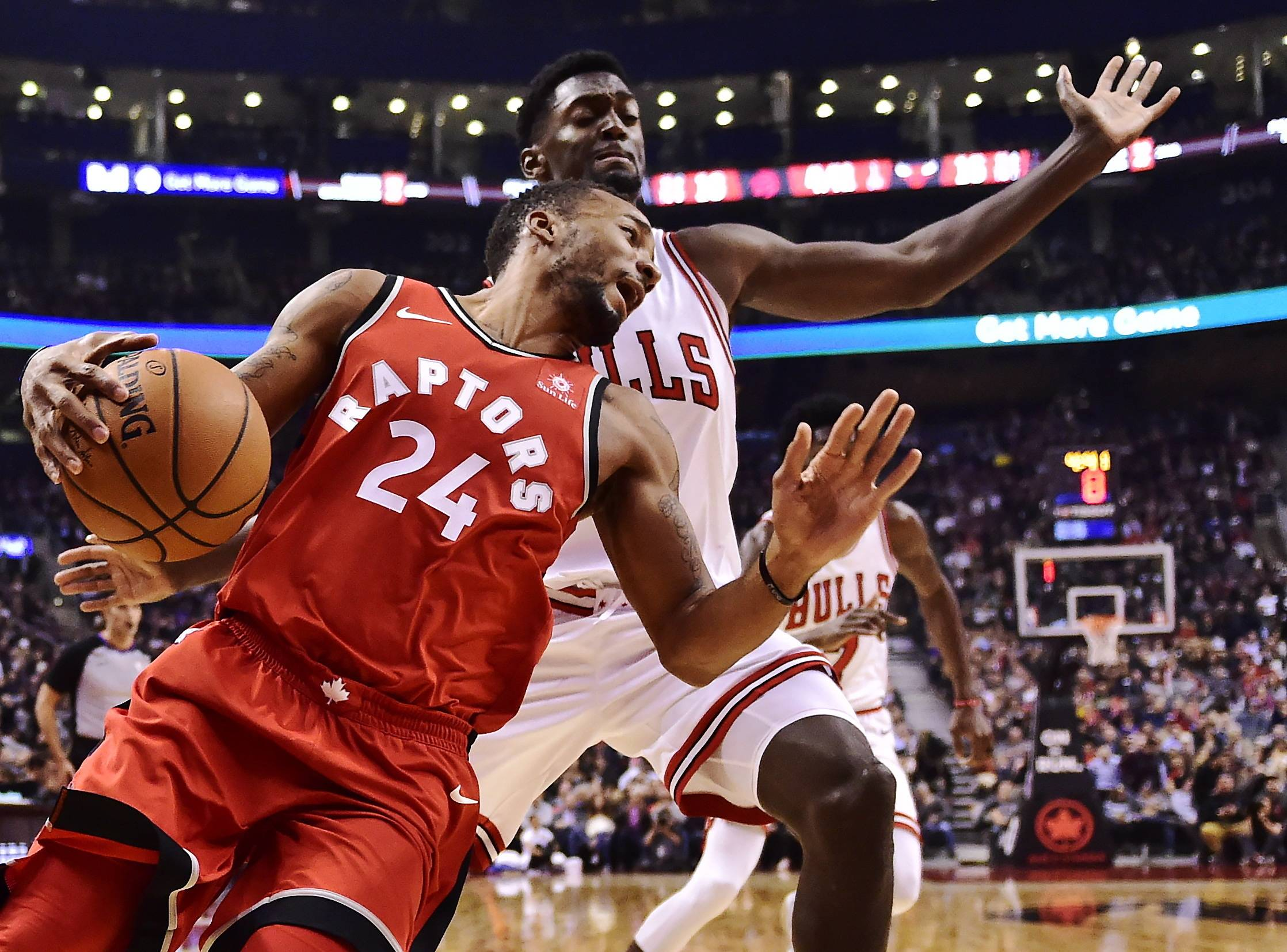 Toronto Raptors forward Norman Powell (24) tries to get past Chicago Bulls forward Bobby Portis (5) during the first half of an NBA basketball game, Tuesday, Nov. 7, 2017 in Toronto. (Frank Gunn/The Canadian Press via AP)