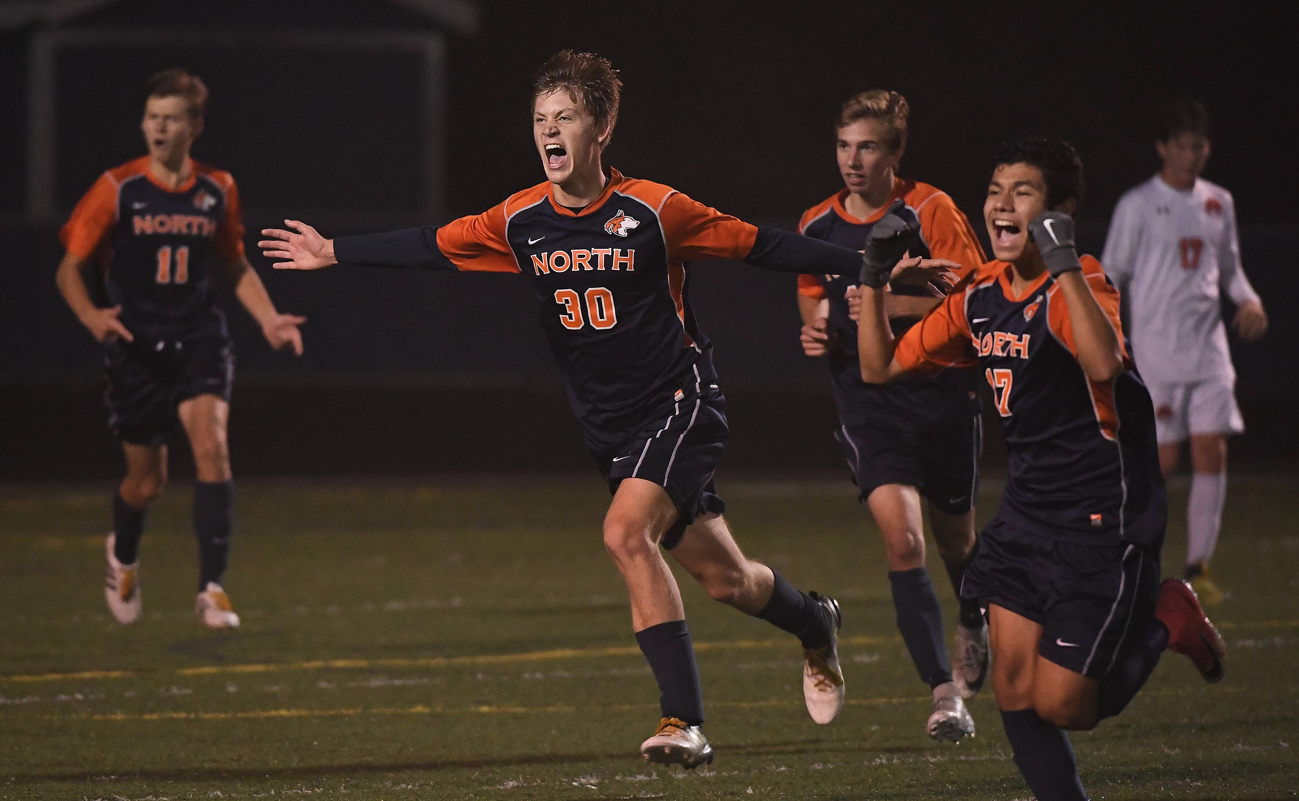 Naperville North's Colin Iverson celebrates his goal for the only score which was enough to top Libertyville for a state soccer championship at Hoffman Estates.