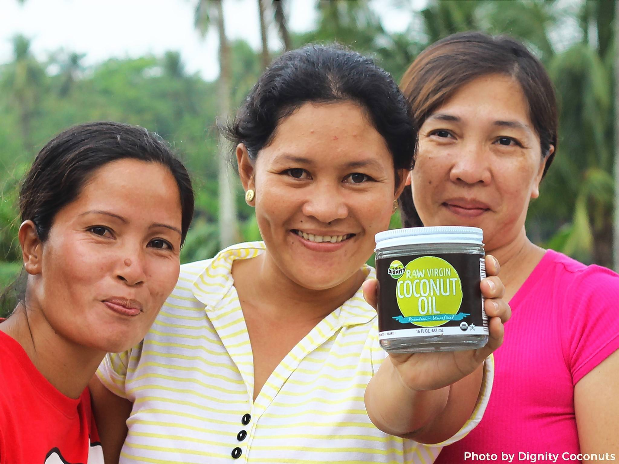 Employees of the Dignity Coconut plant in the Philippines with one of the products that is reviving the economy in their community. The company was started by Vineyard Church of Elgin members.