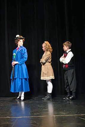 "Westminster Christian School will present ""Mary Poppins"" at the Hemmens in Elgin. In this scene, Mary Poppins (Brynn Maxwell) leads Jane (Molly Fraser) and Michael Banks (Chris Frage) on an outing to the park."
