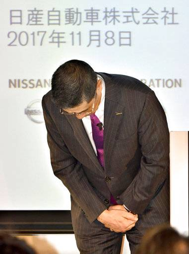 Nissan Chief Executive Hiroto Saikawa bows as Saikawa apologized to customers, dealers, partners and government authorities for the recent faulty inspections scandal, at the start of a press conference in Yokohama, near Tokyo, Wednesday, Nov. 8, 2017.  Japanese automaker Nissan Motor Co. is seeing fiscal second-quarter profit slip 3 percent despite growing sales because of costs related to improper vehicle checks in Japan and a massive global air-bag recall in the U.S.  Nissan, allied with Renault SA of France, reported Wednesday a July-September profit of 141.6 billion yen ($1.2 billion), down from 146.1 billion yen the same period last year. (Kyodo News via AP)