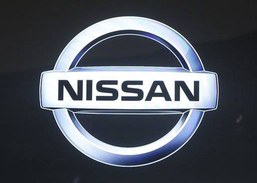 In this Oct. 25, 2017, photo, Nissan Motor Co. logo is displayed at the Tokyo Auto show in Tokyo. Japanese automaker Nissan Motor Co. is seeing fiscal second-quarter profit slip 3 percent despite growing sales because of costs related to improper vehicle checks in Japan and a massive global air-bag recall in the U.S.  Nissan, allied with Renault SA of France, reported Wednesday, Nov. 8, 2017,  a July-September profit of 141.6 billion yen ($1.2 billion), down from 146.1 billion yen the same period last year.