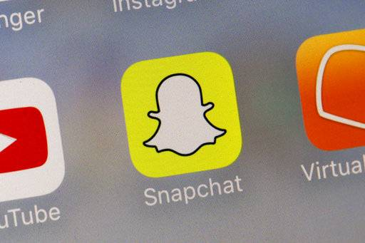 This Wednesday, Aug. 9, 2017, photo shows the Snapchat app. Snap Inc. reports earnings, Tuesday, Nov. 7, 2017. (AP Photo/Richard Drew)