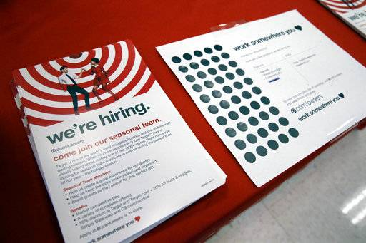 In this Sunday, Oct. 15, 2017, photo, information on available jobs lies on display at a Target store in Chicago. On Tuesday, Nov. 7, 2017, the Labor Department reports on job openings and labor turnover for September. (AP Photo/Nam Y. Huh)