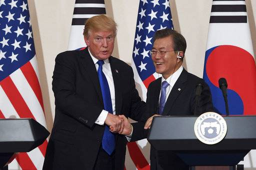 U.S. President Donald Trump, left, and South Korean President Moon Jae-In shake hands during a joint press conference at the presidential Blue House in Seoul, South Korea, Tuesday, Nov. 7, 2017. (Jung Yeon-Je/Pool Photo via AP)
