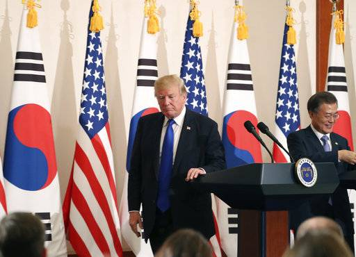 "President Donald Trump, left, leaves a joint news conference with South Korean President Moon Jae-in, right, at the Blue House in Seoul, South Korea, Tuesday, Nov. 7, 2017. President Trump, on his first day on the Korean peninsula, signaled a willingness to negotiate with North Korea to end its nuclear weapons program, urging Pyongyang to ""come to the table"" and ""make a deal."""