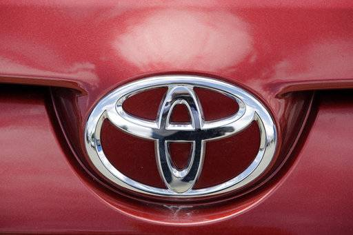 FILE - This Tuesday, June 13, 2017, file photo shows the Toyota logo on a car at Mark Miller Toyota in Salt Lake City. Toyota Motor Corp. is seeing a 16 percent gain in fiscal second quarter profit as sales grew, and a cheaper yen offset higher marketing costs. Toyota, Japan's top automaker, reported Tuesday, Nov. 7, 2017 its July-September profit totaled 458.2 billion yen ($4 billion), up from 393.7 billion yen the same period last year. (AP Photo/Rick Bowmer, File)