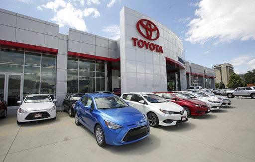 FILE - This Tuesday, June 13, 2017, photo shows the Mark Miller Toyota dealership in Salt Lake City.  Toyota Motor Corp. is seeing a 16 percent gain in fiscal second quarter profit as sales grew, and a cheaper yen offset higher marketing costs. Toyota, Japan's top automaker, reported Tuesday, Nov. 7, 2017 its July-September profit totaled 458.2 billion yen ($4 billion), up from 393.7 billion yen the same period last year.