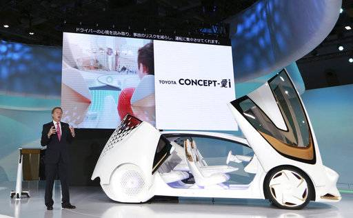 FILE - In this Oct. 25, 2017 file photo, Didier Leroy, executive vice president of Toyota Motor Corp., presents a Toyota Concept-i concept car during the media preview of the Tokyo Motor Show in Tokyo.  Toyota Motor Corp. is seeing a 16 percent gain in fiscal second quarter profit as sales grew, and a cheaper yen offset higher marketing costs. Toyota, Japan's top automaker, reported Tuesday, Nov. 7, 2017 its July-September profit totaled 458.2 billion yen ($4 billion), up from 393.7 billion yen the same period last year.