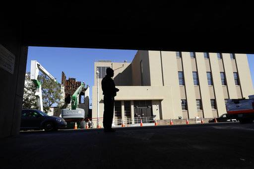 In this photo taken Oct. 26, 2017, Albert Brown III, who works as a security officer, looks out onto the street at a street corner near his work in San Carlos, Calif. Brown recently signed a lease for half of a $3,400 two-bedroom unit in Half Moon Bay, about 13 miles from his job. He can barely afford the rent on his $16-an-hour salary, even with overtime, but the car that doubled as his home needed a pricey repair and he found a landlord willing to overlook his lousy credit.