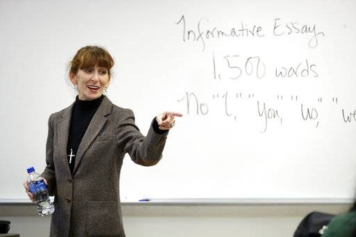 In this photo taken Oct. 11, 2017, Ellen Tara James-Penney, a lecturer at San Jose State University, speaks to her English class on the university's campus in San Jose, Calif. The booming economy along the West Coast has led to an historic shortage of affordable housing and has upended the stereotypical view of people out on the streets. Reporting by The Associated Press finds that many of them are employed, working as retail clerks, plumbers, janitors _ even teachers. They go to work, sleep where they can and buy gym memberships for a place to shower.
