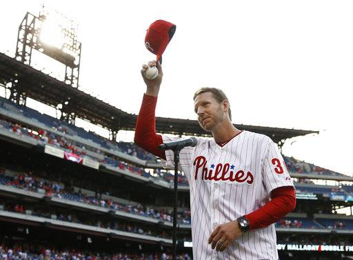 FILE - In this Aug. 8, 2014, file photo, former Philadelphia Phillies' Roy Halladay acknowledges the crowd before a baseball game against the New York Mets, in Philadelphia. Authorities have confirmed that former Major League Baseball pitcher Roy Halladay died in a small plane crash in the Gulf of Mexico off the coast of Florida, Tuesday, Nov. 7, 2017.