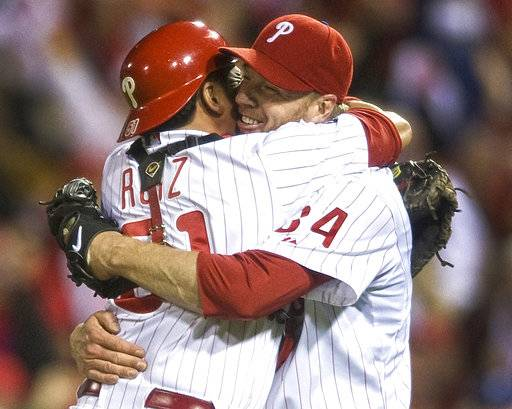 ILE - In this Oct. 6, 2010, file photo, Philadelphia Phillies starting pitcher Roy Halladay celebrates with catcher Carlos Ruiz (51) after throwing a no-hitter to defeat the Cincinnati Reds 4-0 during Game 1 of baseball's National League Division Series, in Philadelphia. Authorities have confirmed that former Major League Baseball pitcher Roy Halladay died in a small plane crash in the Gulf of Mexico off the coast of Florida, Tuesday, Nov. 7, 2017. (Jose F. Moreno/Camden Courier-Post via AP, File)