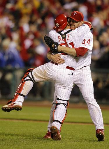 FILE - In this Oct. 6, 2010, file photo, Philadelphia Phillies starting pitcher Roy Halladay celebrates with catcher Carlos Ruiz (51) after throwing a no-hitter to defeat the Cincinnati Reds 4-0 during Game 1 of baseball's National League Division Series, in Philadelphia. Authorities have confirmed that former Major League Baseball pitcher Roy Halladay died in a small plane crash in the Gulf of Mexico off the coast of Florida, Tuesday, Nov. 7, 2017.