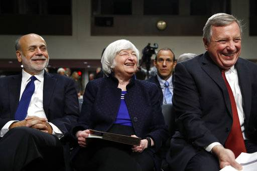 Former Federal Reserve Chair Ben Bernanke, left, Federal Reserve Chair Janet Yellen, and Sen. Dick Durbin, D-Ill., attend a ceremony awarding Bernanke and Yellen with the Paul H. Douglas Award for Ethics in Government, Tuesday, Nov. 7, 2017, on Capitol Hill in Washington.
