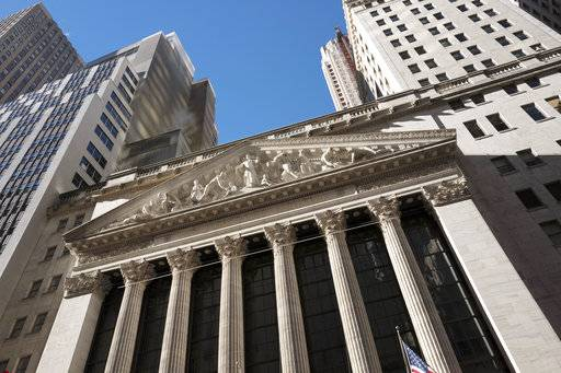 FILE - This Dec. 21, 2016, file photo shows the New York Stock Exchange. Global stocks are mostly higher, Tuesday, Nov. 7, 2017, amid news of corporate deals. (AP Photo/Mark Lennihan, File)