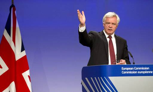 FILE- In this Thursday, Aug. 31, 2017 file photo, British Secretary of State for Exiting the European Union David Davis speaks during a media conference at EU headquarters in Brussels. Britain is promising European Union citizens the right to appeal if they are denied permission to live in the U.K. after Brexit, it was reported Tuesday, Nov. 7, 2017.
