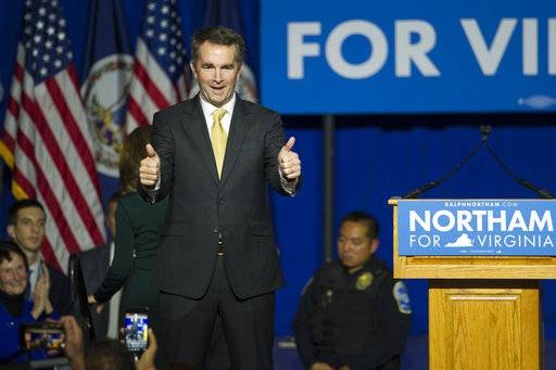 Virginia Gov.-elect Ralph Northam walks onstage to celebrate his election at the Northam For Governor election night party at George Mason University in Fairfax, Va., Tuesday, Nov. 7, 2017. (AP Photo/Cliff Owen)