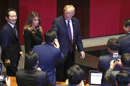 President Donald Trump, center, and first lady Melania Trump, center left, arrive at the South Korean National Assembly, Wednesday, November, 8, 2017, in Seoul, South Korea. Trump is on a five country trip through Asia traveling to Japan, South Korea, China, Vietnam and the Philippines. (AP Photo/Andrew Harnik)