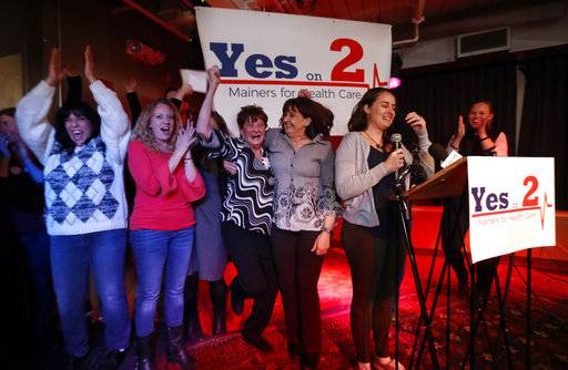 Supporters of Medicaid expansion celebrate their victory, Tuesday, Nov. 7, 2017, in Portland, Maine. Maine voters say they want to join 31 other states in expanding Medicaid under the Affordable Care Act, the signature health bill of former President Barack Obama.