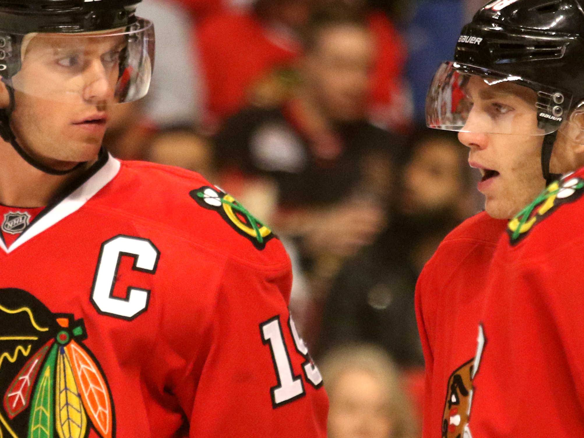 Chicago Blackhawks center Jonathan Toews (19) and Chicago Blackhawks right wing Patrick Kane (88) talk in a time out during an NHL game at the United Center in Chicago Thursday night.