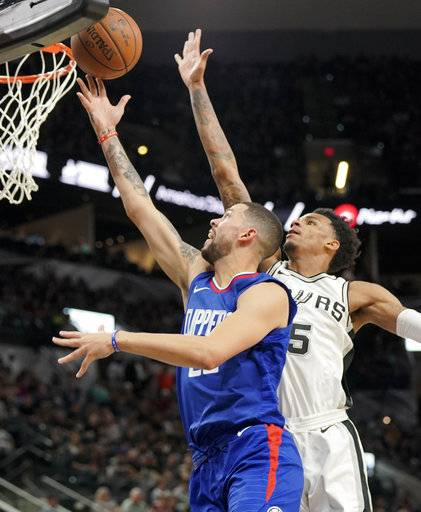 Los Angeles Clippers guard Austin Rivers, left, shoots against San Antonio Spurs guard Dejounte Murray during the first half of an NBA basketball game, Tuesday, Nov. 7, 2017, in San Antonio.