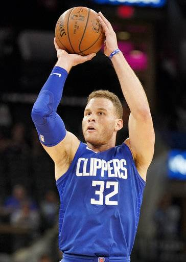 Los Angeles Clippers forward Blake Griffin shoots during the first half of the team's NBA basketball game against the San Antonio Spurs, Tuesday, Nov. 7, 2017, in San Antonio.