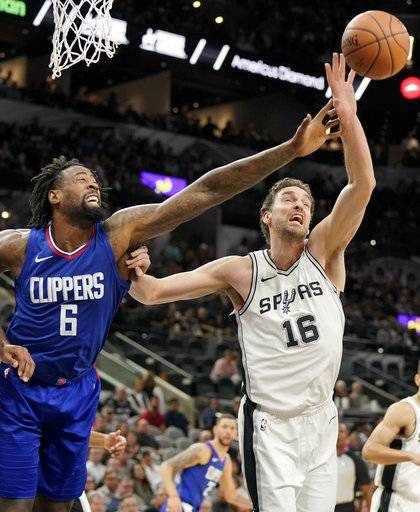 Los Angeles Clippers center DeAndre Jordan (6) chases the rebound against San Antonio Spurs' Pau Gasol, of Spain, during the first half of an NBA basketball game, Tuesday, Nov. 7, 2017, in San Antonio.