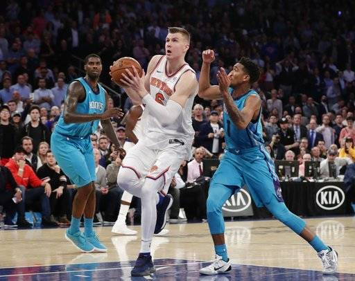 New York Knicks' Kristaps Porzingis (6) drives past Charlotte Hornets' Malik Monk (1) to score during the second half of an NBA basketball game Tuesday, Nov. 7, 2017, in New York. The Knicks won 118-113.