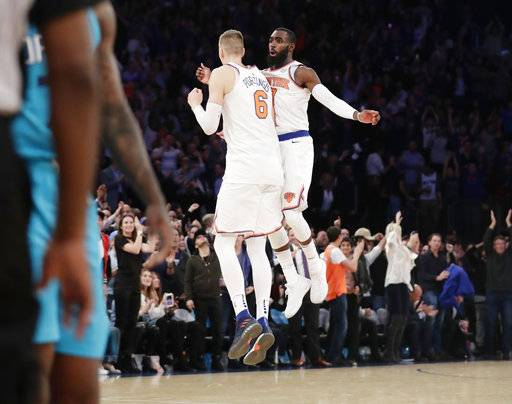 New York Knicks' Kristaps Porzingis (6) celebrates with Tim Hardaway Jr. after scoring late in the second half of an NBA basketball game against the Charlotte Hornets on Tuesday, Nov. 7, 2017, in New York. The Knicks won 118-113.