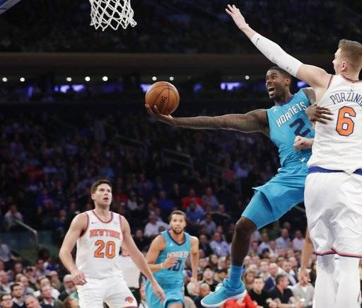 Charlotte Hornets' Marvin Williams (2) drives past New York Knicks' Kristaps Porzingis (6) during the first half of an NBA basketball game Tuesday, Nov. 7, 2017, in New York.