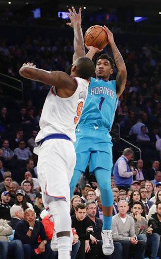Charlotte Hornets' Malik Monk (1) shoots over New York Knicks' Kyle O'Quinn (9) during the first half of an NBA basketball game Tuesday, Nov. 7, 2017, in New York.
